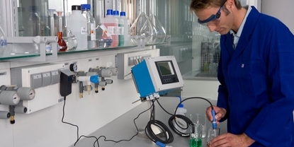 Employee in the laboratory performing calibration