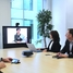 Customers watching a online seminar of Endress+Hauser in a meeting room