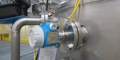 A level switch, located near the top of a tank, detects possible overflow conditions.